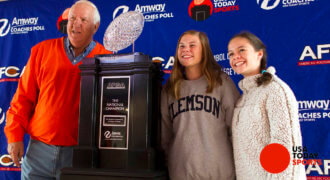 Nov 11, 2017; Clemson, SC, USA; Former Clemson Tigers head coach Danny Ford poses with the AFCA Coaches Trophy presented by Amway, outside Clemson Memorial Stadium before the game between the Clemson Tigers and the Florida State Seminoles. Credit: Joshua S. Kelly-USA TODAY Sports