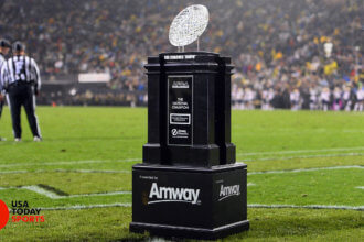 The AFCA Coaches Trophy presented by Amway sits on the turf during the first half of the game between the Washington Huskies against the Colorado Buffaloes. The iconic Waterford Crystal Football will be presented to the No. 1 team in the Amway Coaches Poll and national champion at the end of the season. It has been awarded to the Coaches National Champion since 1986 and made available to all Coaches Poll winners since 1950.