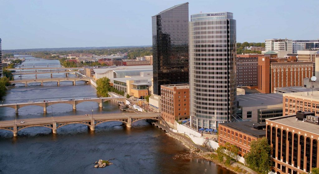 An aerial view of the skyline of Grand Rapids, Michigan, showing the JW Marriott Hotel, the Amway Grand Plaza and the DeVos Place Convention Center.