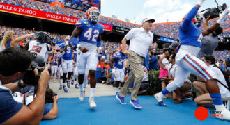 Florida Gators head football coach Dan Mullen and his team run out of the tunnel prior to the game against the Tennessee Volunteers at Ben Hill Griffin Stadium.