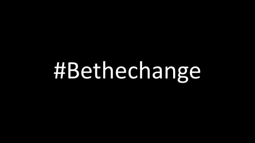A black background with the hashtag #Bethechange in white letters