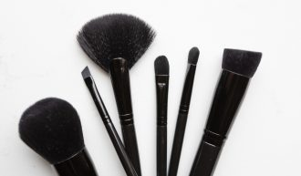 A collection of Artistry makeup brushes