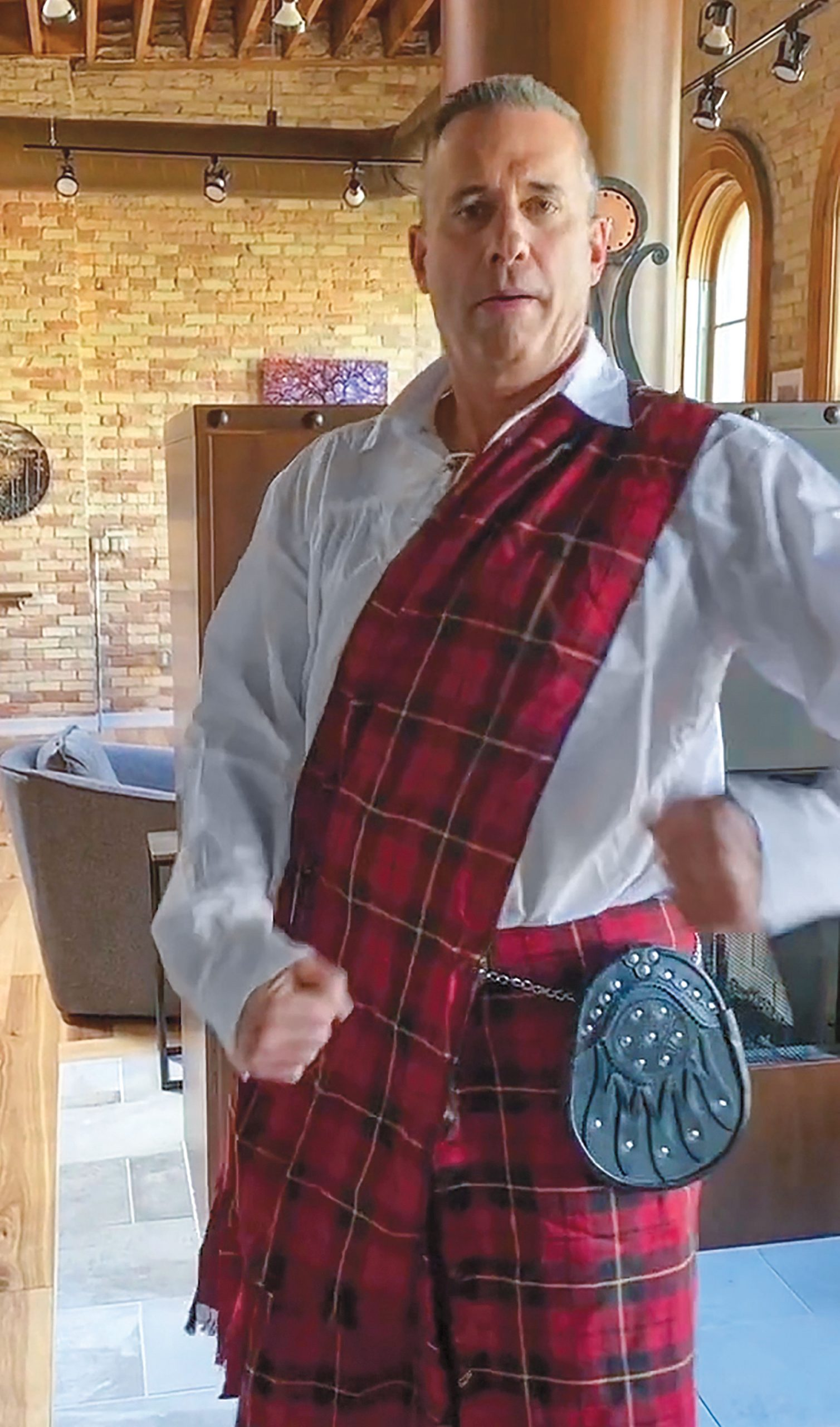 Amway North America Managing Director Jim Ayres honors his Scottish heritage by wearing a kilt for the charity dance competition.