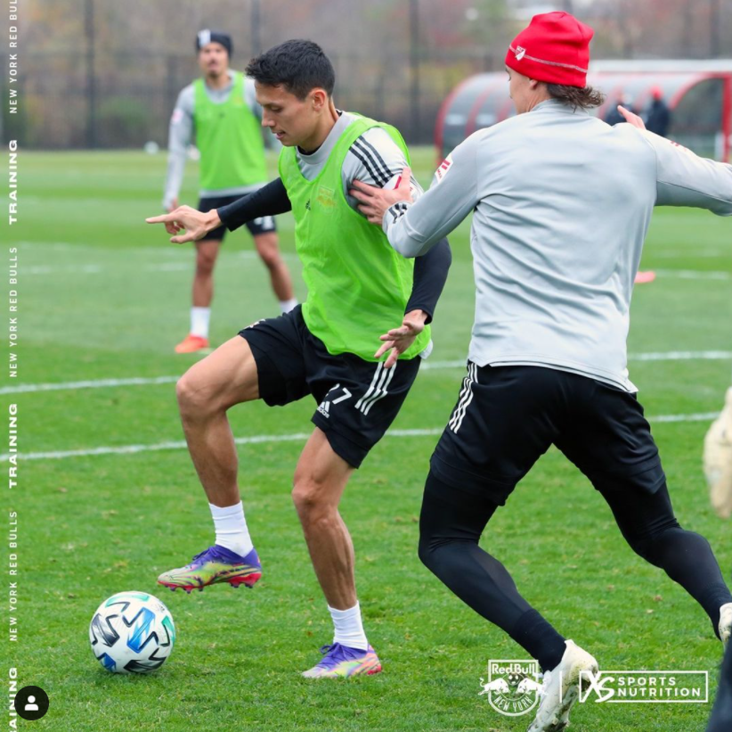 An image of New York Red Bull Soccer players practicing that was posted on the team's Instagram page. It shows the XS Sports Nutrition logo in the lower right corner.